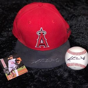 | Autographed Hat/Ball/Card by MLB Angels Pitcher